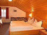 Schlafzimmer - Thomanhof - Abenteuerurlaub am Bauernhof Saalfelden